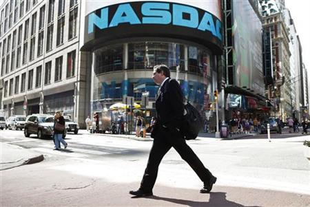 A pedestrian walks past the NASDAQ building in New York City, April 30, 2010.REUTERS/Lucas Jackson