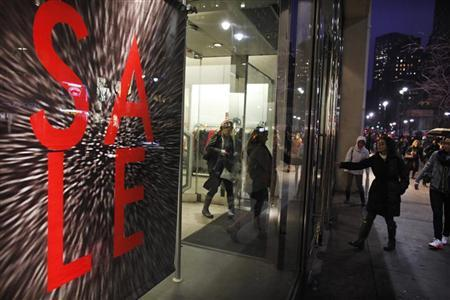 Shoppers leave and enter a store in New York January 12, 2012. REUTERS/Eduardo Munoz