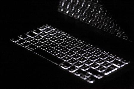 Backlit keyboard is reflected in screen of Apple Macbook Pro notebook computer in Warsaw February 6, 2012. REUTERS/Kacper Pempel