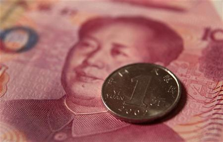 A Chinese one yuan coin and a 100 yuan banknote are seen in this picture illustration taken in Beijing December 30, 2010. REUTERS/Petar Kujundzic