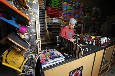Professional skateboarder Jordan Hoffart sets up a new skateboard at a shop in Escondido, California January 5, 2012.    REUTERS/Mike Blake
