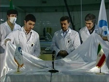 Iran's President Mahmoud Ahmadinejad looks on next to scientists unveiling a fuel rod at the Tehran Research Reactor in Tehran, in this still image taken from video February 15, 2012.  REUTERS/IRIB Iranian TV via Reuters TV
