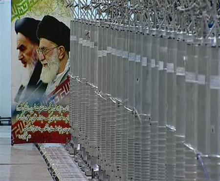 A poster of Iran's Supreme Leader Ayatollah Ali Khamenei and the late Ayatollah Ruhollah Khomeini is seen next to bank of centrifuges in what is described by Iranian state television as a facility in Natanz, in this still image taken from video released February 15, 2012. REUTERS/IRIB Iranian TV via Reuters TV