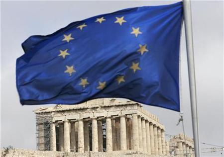 A European Union flag waves in front of the monument of Parthenon on Acropolis hill in Athens, March 5, 2009.   REUTERS/John Kolesidis