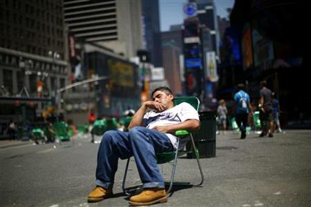 A man sleeps in a chair along a closed portion of Broadway in NYC, 07/06/2009. Reuters/Eric Thayer