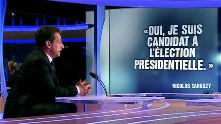France's President Nicolas Sarkozy appears on France TF1 television prime time news programme as he formally declares his candidacy for a second term, during an interview with journalist Laurence Ferrari at their studios in Boulogne-Billancourt, near Paris February 15, 2012.    REUTERS/TF1 Television