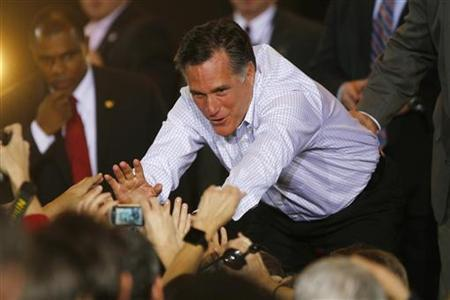 Republican presidential candidate and former Massachusetts Governor Mitt Romney greets supporters during a campaign event in Mesa, Arizona February 13, 2012. REUTERS/Joshua Lott
