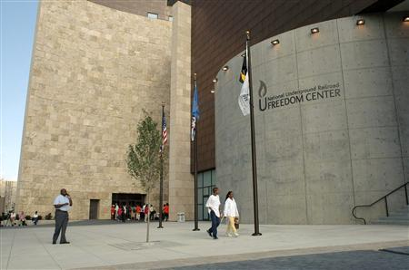 Visitors walk past the National Underground Railroad Freedom Center before the dedication ceremony in downtown Cincinnati in this August 23, 2004 file photo.   REUTERS/Tom Uhlman/Files