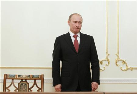 Vladimir Putin waits during a signing ceremony at the Novo-Ogaryovo residence outside Moscow in this March 21, 2011 file photo.  REUTERS/Denis Sinyakov