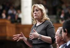 Canada's Labour Minister Lisa Raitt speaks during Question Period in the House of Commons on Parliament Hill in Ottawa February 15, 2012.       REUTERS/Chris Wattie