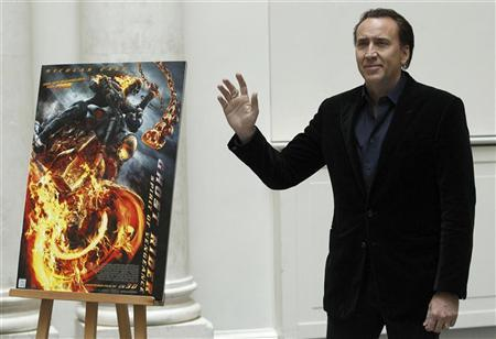 Nicolas Cage poses to promote his movie 'Ghost Rider: Spirit of Vengeance' in Berlin January 23, 2012. The movie opens in German cinemas on February 23.  REUTERS/Tobias Schwarz