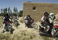 Taliban fighters ride on motorbikes in an undisclosed location in Afghanistan July 14, 2009. REUTERS/Stringer