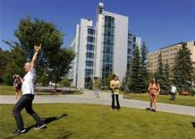 Students play a game of pickup baseball on campus at the University of Calgary in Calgary, Alberta August 26, 2010. REUTERS/Todd Korol (CANADA - Tags: EDUCATION)