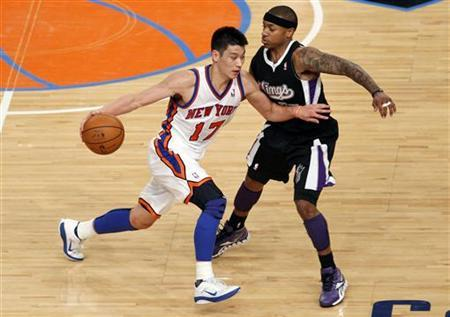 New York Knicks' Jeremy Lin drives into Sacramento Kings' Isaiah Thomas during the third quarter of their NBA basketball game in New York's Madison Square Garden, February 15,  2012.   REUTERS/Mike Segar