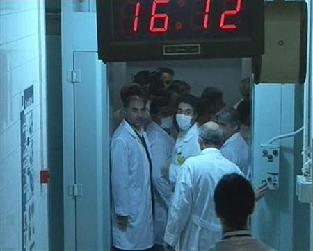 A group of scientists are seen near the control room area at the Tehran Research Reactor in Tehran, in this still image taken from video February 15, 2012. REUTERS/IRIB Iranian TV via Reuters TV