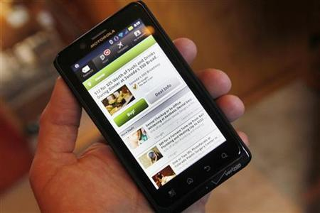 The Groupon smartphone app is seen on a Motorola Droid Bionic cellphone in Denver November 4, 2011.   REUTERS/Rick Wilking