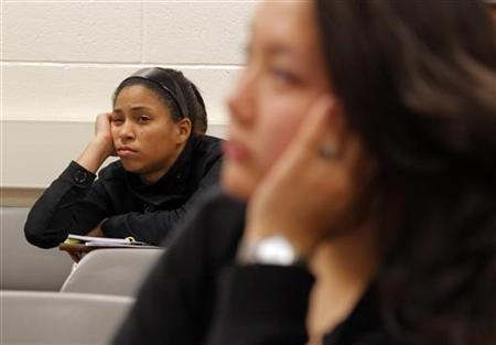 Students listen to professor Christian Agunwamba during their ''Fundamentals of Algebra'' class, which is held from 11:45pm to 2:30am, at Bunker Hill Community College in Boston, Massachusetts September 9, 2010, one of five midnight classes offered this semester due to surging enrollment. Bunker Hill's experiment with ''midnight oil'' classes began with two classes a year ago and a handful of other colleges, from Maryland to Illinois to California, have followed Bunker Hill's lead and are offering midnight classes to cope with overflowing enrollment. Picture taken September 9, 2010.  REUTERS/Brian Snyder    (UNITED STATES - Tags: EDUCATION SOCIETY)