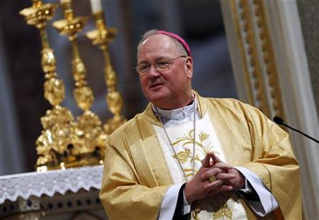 New York Archbishop Timothy Dolan leads a mass at St. John Lateran's Basilica in Rome February 15, 2012. REUTERS/Tony Gentile
