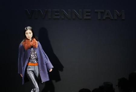 A model presents a creation from the Vivienne Tam Fall/Winter 2012 collection during New York Fashion Week February 15, 2012.  REUTERS/Kena Betancur