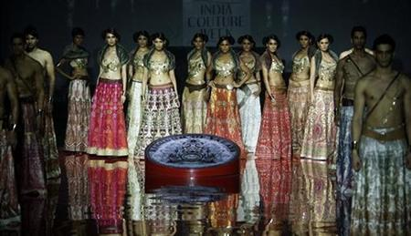 Models display creations by designer JJ Valaya at the India Couture Week in Mumbai September 17, 2008. REUTERS/Punit Paranjpe/Files