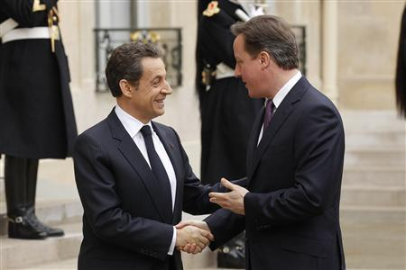 France's President Nicolas Sarkozy (L) greets Britain's Prime Minister David Cameron as he arrives for a Franco-British summit at the Elysee Palace in Paris, February 17, 2012. REUTERS/Benoit Tessier
