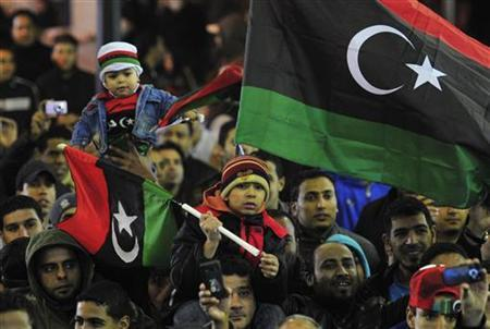 People with the Kingdom of Libya flags gather during a celebration to mark the Revolution of February 17 in Benghazi February 16, 2012. The people are celebrating the one-year anniversary since the revolutionary uprising against Muammar Gaddafi. The flag which was used when Libya gained independence from Italy in 1951, was used as a symbol of resistance against Muammar Gaddafi.   REUTERS/Esam Al-Fetori                (