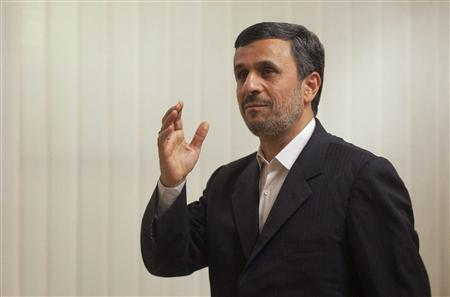 Iran's President Mahmoud Ahmadinejad gestures towards the media before his meeting with Pakistan's Prime Minister Yusuf Raza Gilani (not pictured) at the prime minister's residence in Islamabad February 16, 2012.  REUTERS/Faisal Mahmood