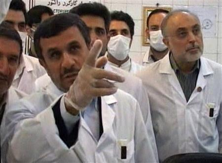 Iran's President Mahmoud Ahmadinejad watches from a control room as nuclear fuel rods are loaded into the Tehran Research Reactor in Tehran, in this still image taken from video February 15, 2012. REUTERS/IRIB Iranian TV via Reuters TV