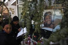 People write messages at the entrance of Whigham Funeral Home, which is handling the funeral service of pop singer Whitney Houston, in Newark, New Jersey February 17, 2012.  REUTERS/Eduardo Munoz