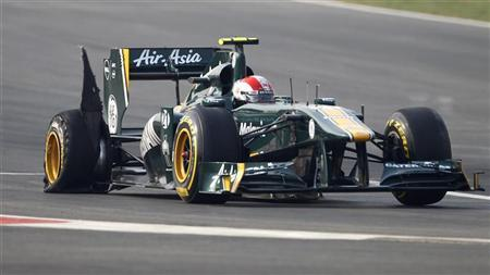 Lotus F1 Formula One driver Jarno Trulli of Italy drives his car with a punctured tyre during the first Indian F1 Grand Prix at the Buddh International Circuit in Greater Noida on the outskirts of New Delhi October 30, 2011. REUTERS/Toru Hanai