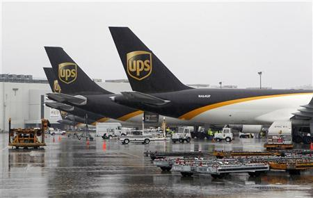 United Parcel Service cargo aircraft are loaded with air containers full of packages bound for their final destination at the UPS Worldport All Points International Hub during the peak delivery day in Louisville, Kentucky, December 22, 2011.   REUTERS/John Sommers II