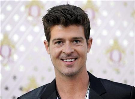 Actor Robin Thicke arrives at Pharrell Williams' launch for his new liqueur in the Beverly Hills area of Los Angeles, California July 15, 2011. REUTERS/Gus Ruelas