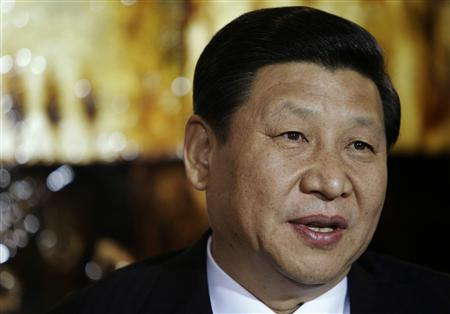 Chinese Vice President Xi Jinping speaks during a visit to the Rick Kimberley family farm, in Maxwell, Iowa February 16, 2012. REUTERS/Charlie Neibergall/Pool