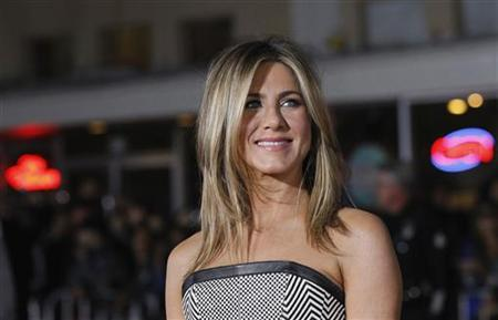 Cast member Jennifer Aniston poses at the premiere of ''Wanderlust'' at the Mann Village theatre in Los Angeles, California February 16, 2012. The movie opens in the U.S. on February 24.  REUTERS/Mario Anzuoni