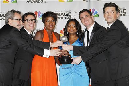 The director, cast and producers of ''The Help'' (L-R) producers Brunson Green,Chris Columbus, actresses Viola Davis, Octavia Spencer, director Tate Taylor and producer Michael Barnathan pose with the Image Award for best motion picture at the 43rd NAACP Image Awards in Los Angeles, California February 17, 2012.  REUTERS/Fred Prouser