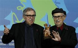 Directors Vittorio (R) and Paolo Taviani hold the Golden Bear award for the best film 'Caesare Deve Morire' ('Caesar Must Die') as they pose during a news conference after the awards ceremony of the 62nd Berlinale International Film Festival in Berlin February 18, 2012.         REUTERS/Tobias Schwarz