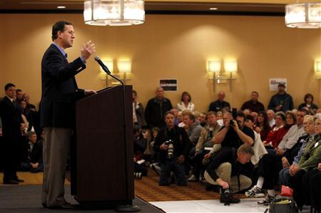 Republican Presidential Candidate Rick Santorum speaks during a Tea Party Rally in Columbus, Ohio February 18, 2012.    REUTERS/Matt Sullivan