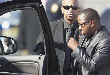 Bobby Brown (R) leaves the funeral service of ex-wife, pop singer Whitney Houston, at the New Hope Baptist Church in Newark, New Jersey February 18, 2012. Houston, 48, died in a Beverly Hills hotel room February 11, the eve of the industry's Grammy Awards.     REUTERS/Carlo Allegri