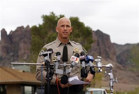 Pinal County Sheriff Paul Babeu speaks during a news conference near the Superstition Mountains where rescue workers searched for victims of a plane crash in Apache Junction, Arizona November 24, 2011.  REUTERS/Joshua Lott