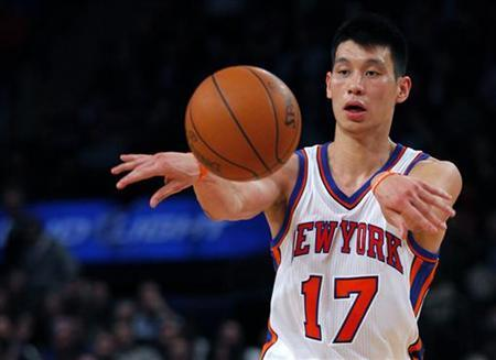 New York Knicks point guard Jeremy Lin passes the ball against the New Orleans Hornets in the second half of their NBA basketball game at Madison Square Garden in New York, February 17, 2012. REUTERS/Adam Hunger