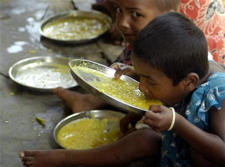 Students have a free meal distributed by a government-run school in Nalchar village, 70 km (44 miles) south of Agartala, the capital of Tripura, April 3, 2008. REUTERS/Jayanta Dey/Files