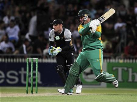 South Africa's Richard Levi (R) plays a shot on his way to 117 not out as New Zealand's Brendon McCullum looks on during their Twenty20 international cricket match in Hamilton, February 19, 2012. REUTERS/Michael Bradley