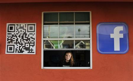 Sarah Hostetler looks out from her home in Buena Park, California February 11, 2012. REUTERS/Josh Edelson