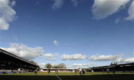 Stevenage (in white) take on Tottenham Hotspur during their English FA Cup soccer match at Broadhall Way in Stevenage, southern England, February 19, 2012. REUTERS/Dylan Martinez