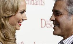 "Cast member George Clooney and actress Stacy Keibler smile at the premiere of ""The Descendants"" at the Samuel Goldwyn Theater in Beverly Hills, California November 15, 2011. The movie opens in the U.S. on Wednesday.  REUTERS/Mario Anzuoni"
