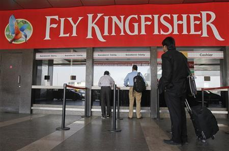 Customers stand at a Kingfisher Airlines reservation office at the domestic airport in Mumbai, February 16, 2012. REUTERS/Vivek Prakash