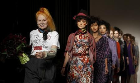 Designer Vivienne Westwood (L) walks on the catwalk with her models after the presentation of her Vivienne Westwood Red Label 2012 Autumn/Winter collection during London Fashion Week February 19, 2012. REUTERS/Suzanne Plunkett