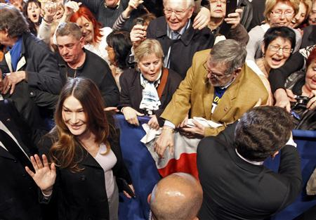 France's First Lady Carla Bruni-Sarkozy (L) greets supporters as France's President Nicolas Sarkozy attends his first major re-election campaign rally in Marseille, southern France, February 19, 2012. REUTERS/Jean-Paul Pelissier