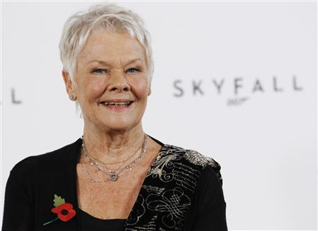 Actress Judi Dench poses while launching the start of production of the new James Bond film ''SkyFall'' at a restaurant in London in this November 3, 2011 file photo. REUTERS/Luke MacGregor/Files