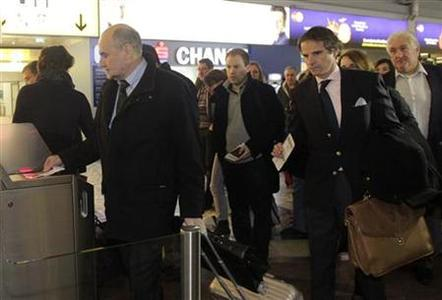 Herman Nackaerts (L), head of a delegation of the International Atomic Energy Agency (IAEA), checks in for a flight to Iran next to other IAEA delegates at the international airport in Vienna February 19, 2012. REUTERS/Herwig Prammer